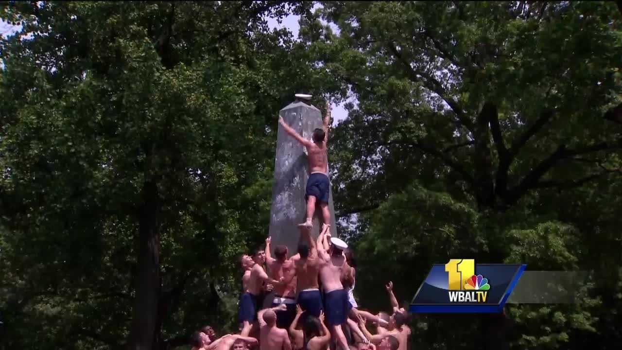 The U.S. Naval Academy's plebe class has capped the Herndon Monument. About 1,000 first-year students took part in this annual tradition Monday afternoon. Chris Bianchi, of Virginia Beach, Virginia, capped the 21-foot obelisk slathered with vegetable shortening with a midshipmen's hat. It was done in one hour, 12 minutes and 30 seconds.