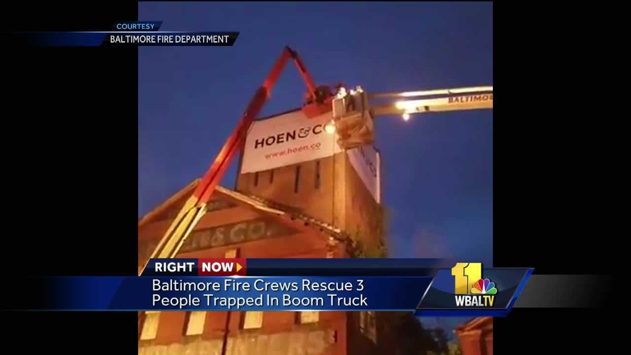 Firefighters rescued three workers trapped five stories up in the air in the bucket of a mobile boom truck Thursday night. Crews were called to the 2100 block of E. Chase Street at 8:30 p.m. on the report of a rescue alarm. When units arrived, they found the workers stuck, about five stories high. The preliminary investigation revealed that the workers were hanging a sign on the building when the machine lost power, causing them to be trapped.