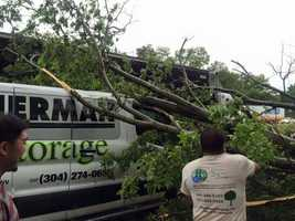 A tree falls on a vehicle on westbound Interstate 70 in Woodlawn.