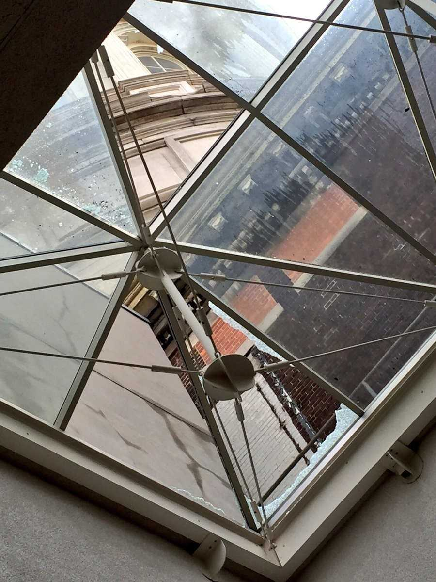 Close call at City Hall: It appears as though a chunk of marble fell through the South Gallery skylight.