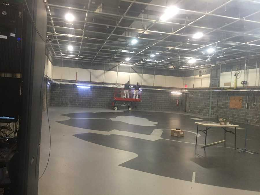 Crews clear the studio to build the new set.