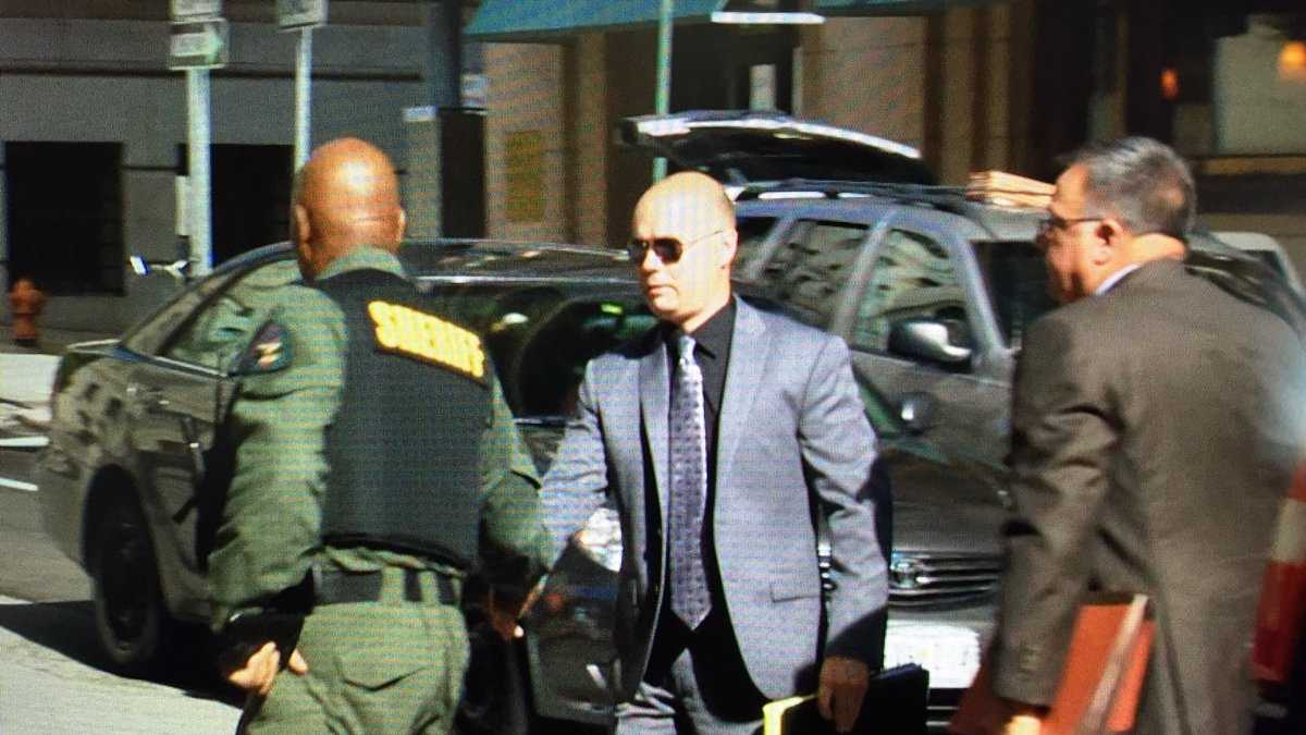Lt. Brian Rice arrives at court prior to a pretrial motions hearing.
