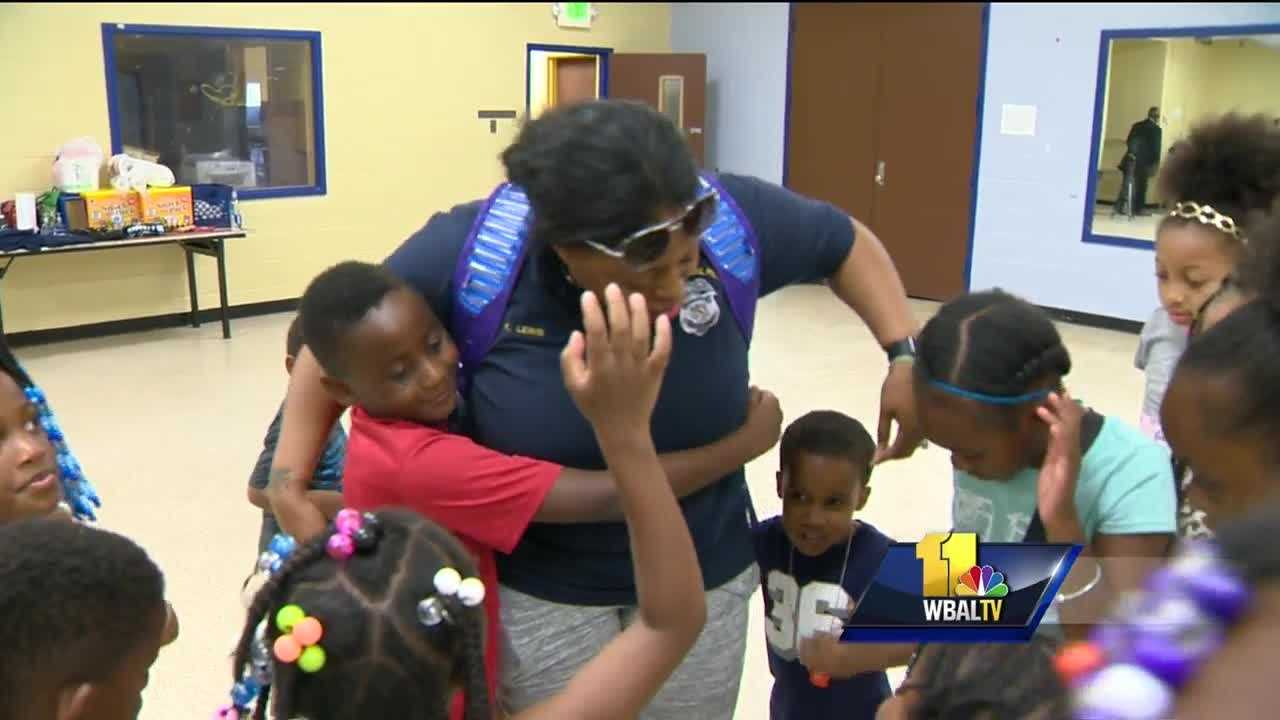 Baltimore's school police officers are lending their time and money this summer to help motivate kids. It's hard to tell who's having the most fun between the students or police officers running the youth camp at the Walter P. Carter Elementary-Middle School. The children range from 5 to 10 years old, and they live in a neighborhood where gun violence has been an issue.