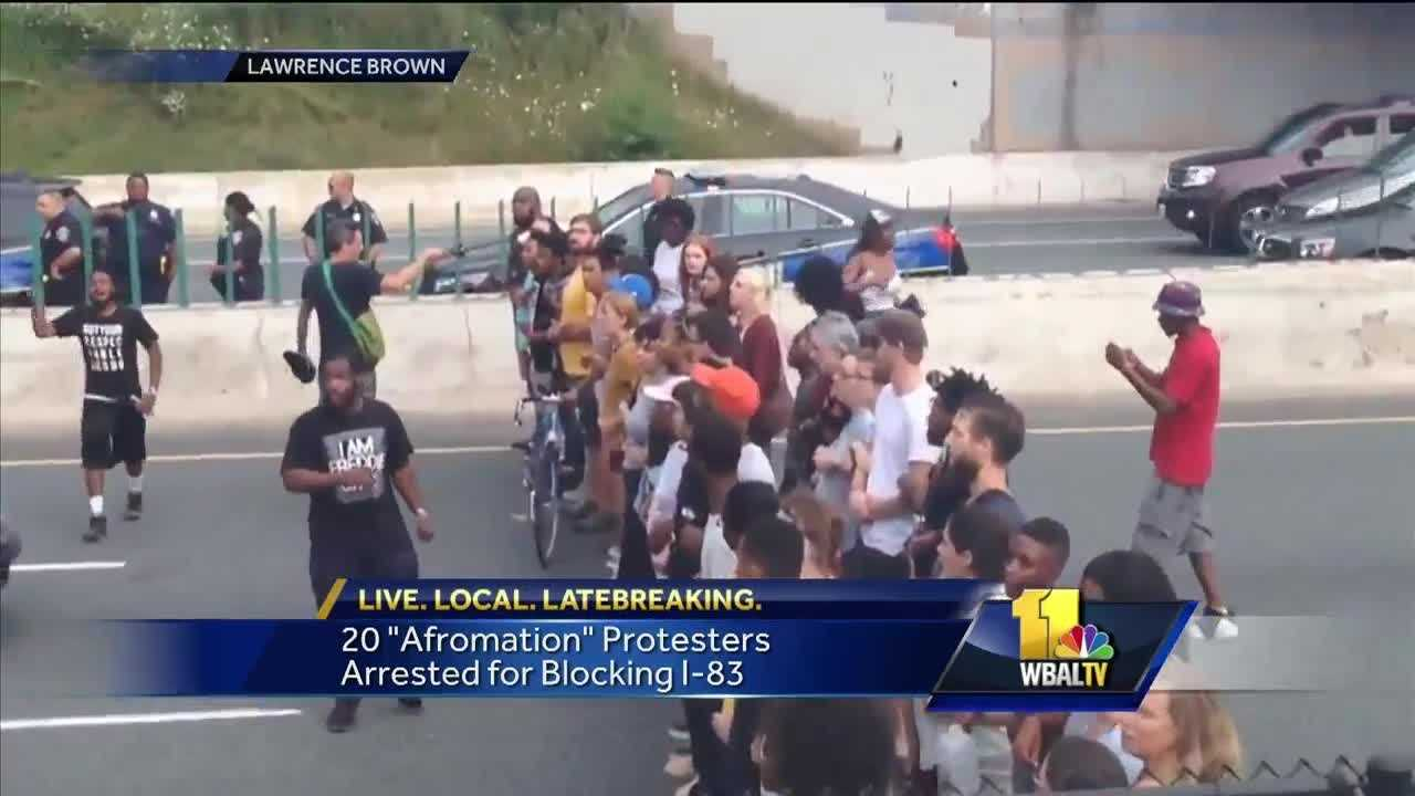 Several dozens of people were arrested Saturday after they blocked traffic along Interstate 83 in Baltimore, police said. The group started and Guilford and Chase before moving through Artscape and then down the Charles Street ramp to interstate, where they locked arms and blocked traffic along the northbound side of the highway, police said. Soon after, officers began making arrests and detained more than 20 protesters. The ramp to I-83 outside Artscape was already closed for the festival.