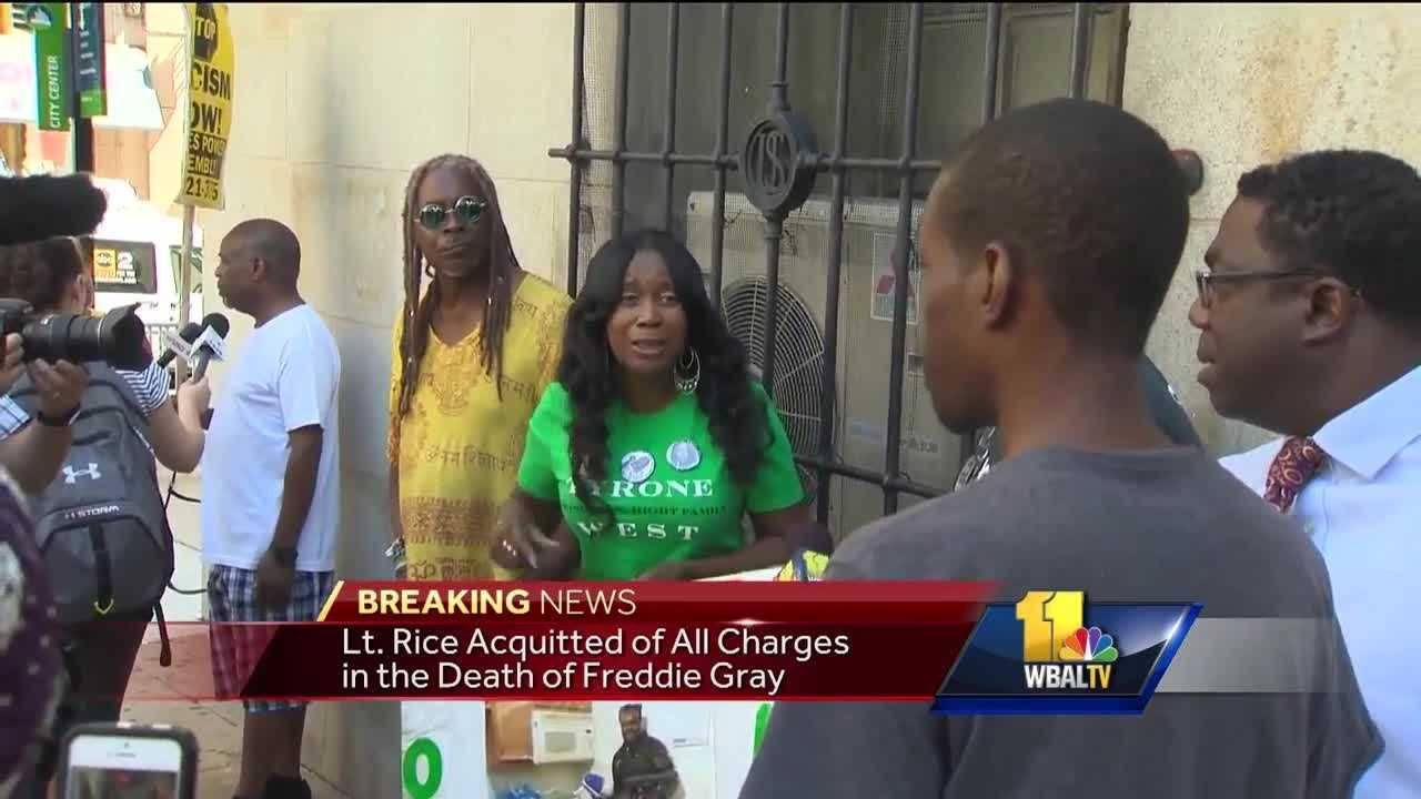 A small group of protesters stood outside Courthouse East after Baltimore Police Lt. Brian Rice was found not guilty on all charges connected with the death of Freddie Gray.