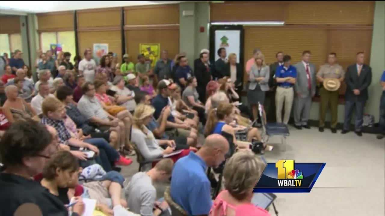 A packed crowd poured into the Ellicott City 50+ Center to meet with government officials as they seek answers on how to move forward after having their businesses, property or cars damaged or destroyed after Saturday's record flood.