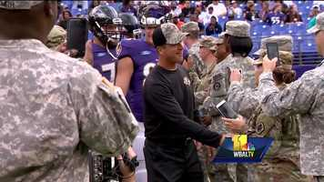 Ravens coach John Harbaugh greets members of the military prior to practice at M&T Bank Stadium.