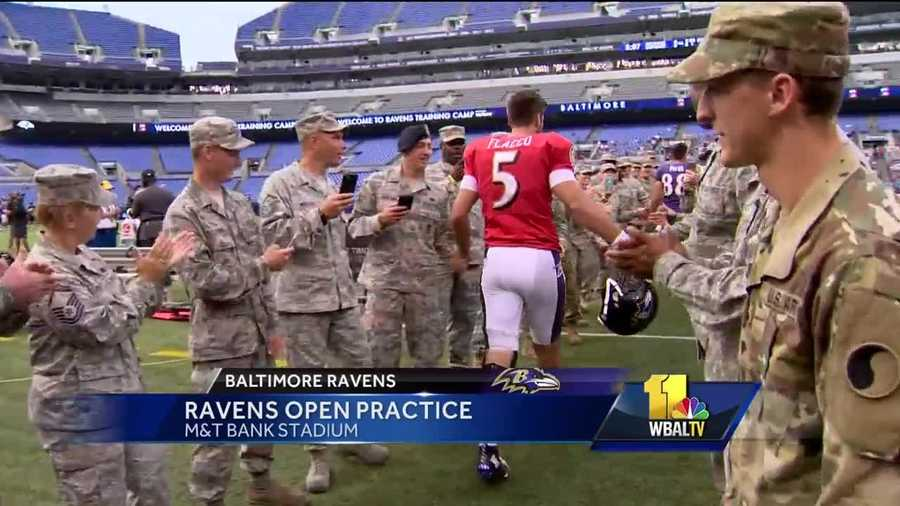 Ravens quarterback Joe Flacco greets members of the military prior to practice at M&T Bank Stadium