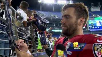Ravens quarterback Joe Flacco signs autographs for fans at M&T Bank Stadium.