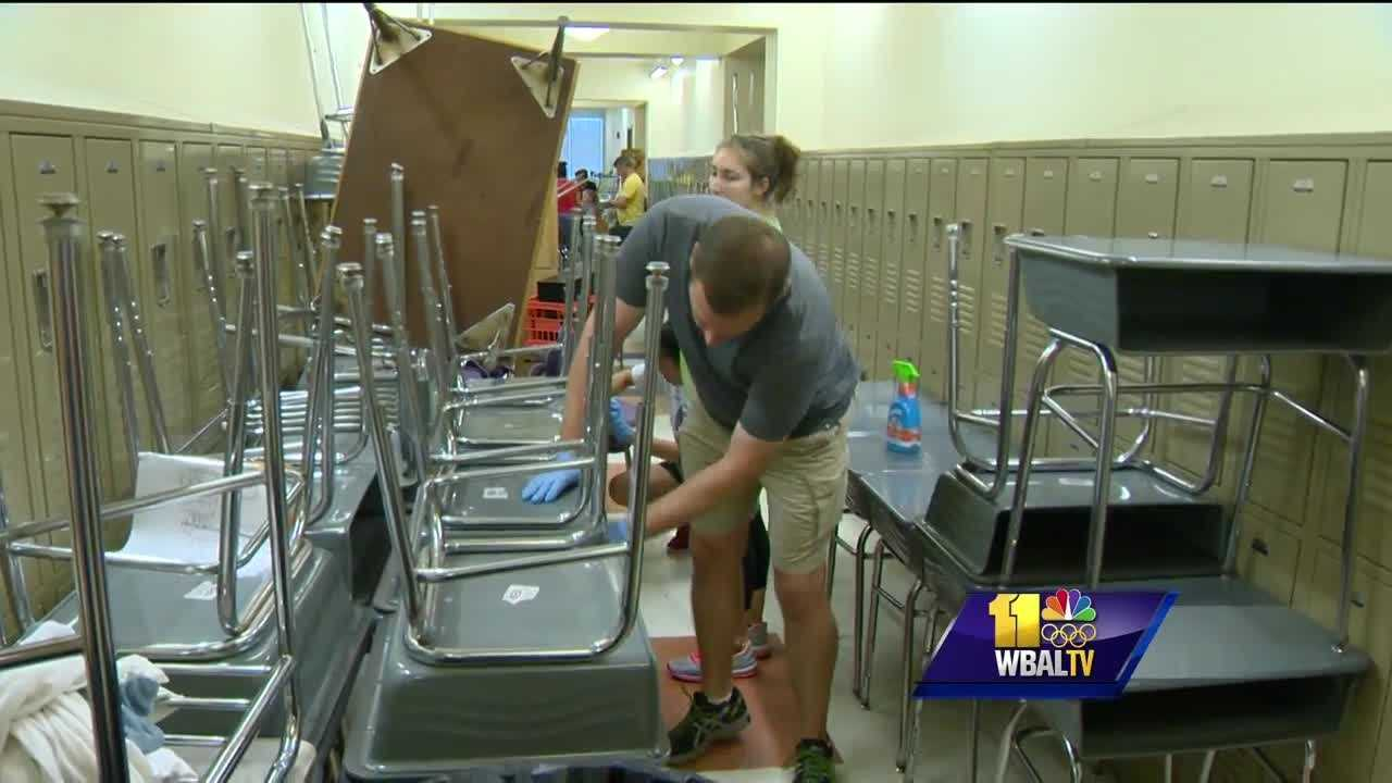 Volunteers are helping to restore a Baltimore school damaged by vandals as police continue to search for suspects. It has been two weeks since someone broke into Violetville Elementary-Middle School, causing more than $70,000 in damage. Since then, staff members have been frantically trying to put the school back in order. They got a big helping hand from the community Friday. On the first floor, the smell of household cleaning products filled the air, replacing an odor of water-soaked classrooms and hallways, left behind by vandals who tripped the sprinkler system, flooding every floor of the building.