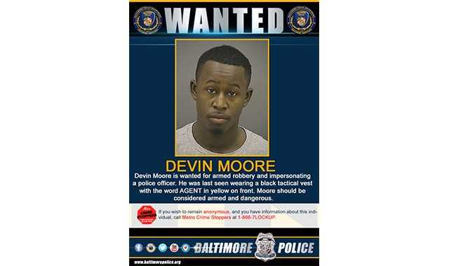 Devin Moore, 21, of the 4500 block of Harcourt Road, is wanted in connection with a pair of robberies where he and three others impersonated a police officer.
