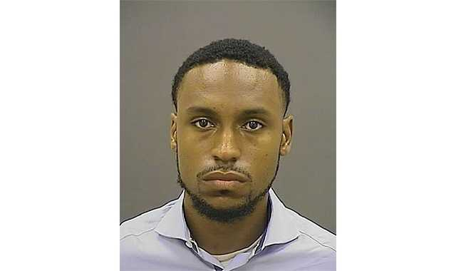 John Waters, 25, of the 5400 block of Masefield Road, turned himself into Baltimore  police. Waters is charged with two counts of armed robbery and impersonating an officer.