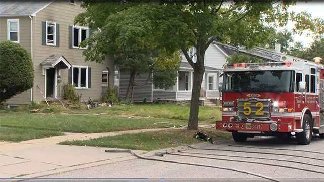 Crews battle house fire in Baltimore