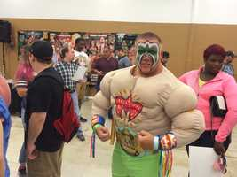 A fan got decked out like the Ultimate Warrior to meet some of his favorite professional wrestlers