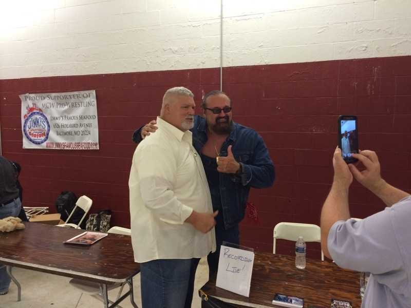 Former WWE wrestlers Tugboat, left, and Hillbilly Jim catch up during the MCW Tribute to the Legends wrestling convention.