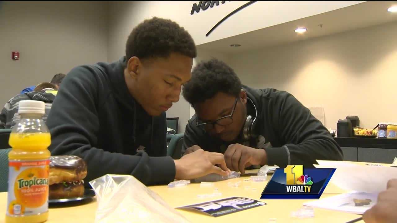 Students from two Baltimore high schools had the chance to create prosthetic hands for children around the world.