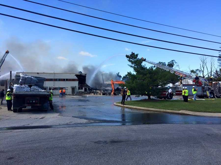 Almost 24 hours after it started, the Adell Plastics warehouse is still burning in Lansdowne.