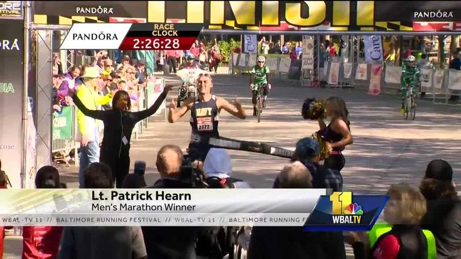 Lt. Patrick Hearn crosses the finish line first in the 2016 Baltimore. Marathon