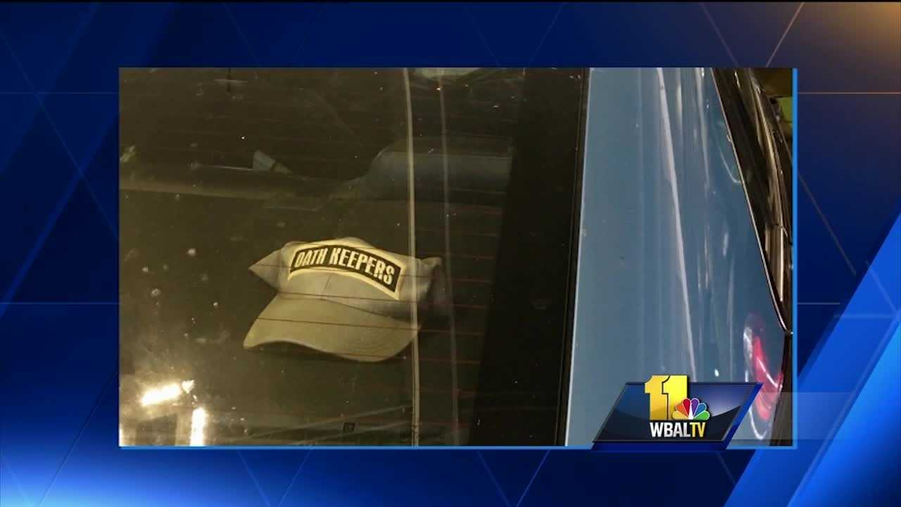 An Anne Arundel County police officer has been suspended after a picture of a police cruiser with a hat inside that had the name of the controversial Oath Keepers group on it was brought to the department's attention, police said.