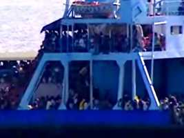 Boats crowded with Haitians were blocked as they tried to get to the USNS Comfort for help.