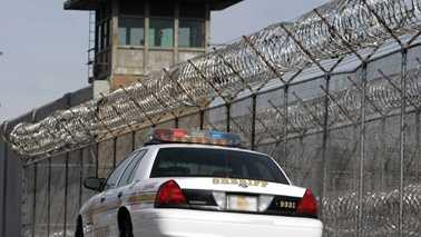 Generic Prison With Sheriff Car Small.jpg
