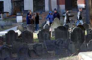 Named for the 12,000 bushel grain storage building that was next door, the graveyard has 2,345 markers.