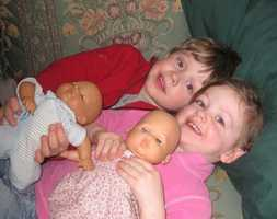 Charlotte and Finn with their dolls Sydney and Peter