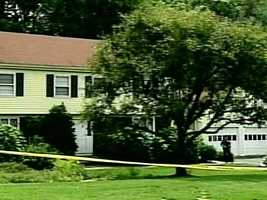 Investigators from the Middlesex County District Attorney's Office and Winchester police were called to this Winchester home in July 2010 for a report of multiple deaths.