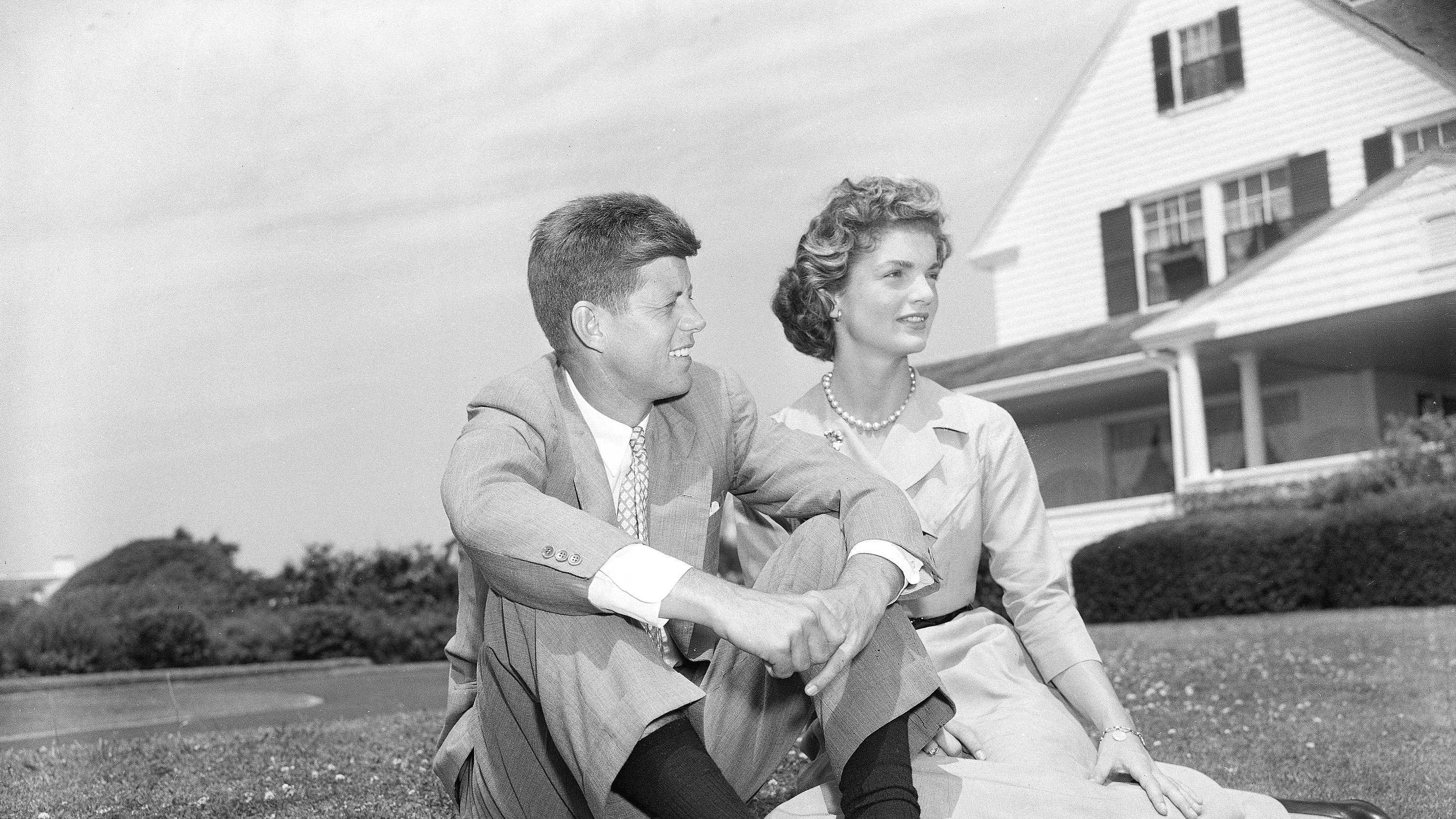 Sen. John F. Kennedy, D-Mass., and his fiancee Jacqueline Bouvier, 23, pose on the lawn of the Kennedy residence during their weekend visit at Hyannis, Ma., on June 27, 1953.
