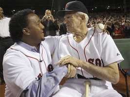 Pedro Martinez greets Pesky on opening night on April 4, 2010.