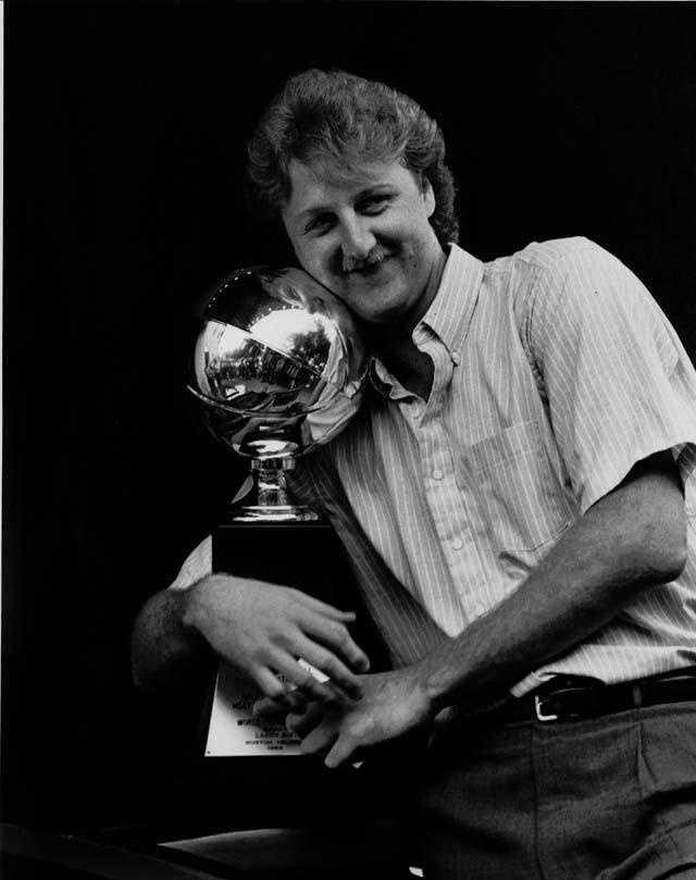 Larry Bird hugs the Most Valuable Player trophy after presentation ceremonies on June 18, 1984.