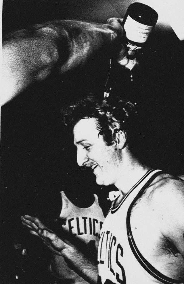 Larry Bird reacts as he has champagne poured on his head on June 12, 1984, after the Celtics defeated the Los Angeles Lakers to take the NBA Championship title.
