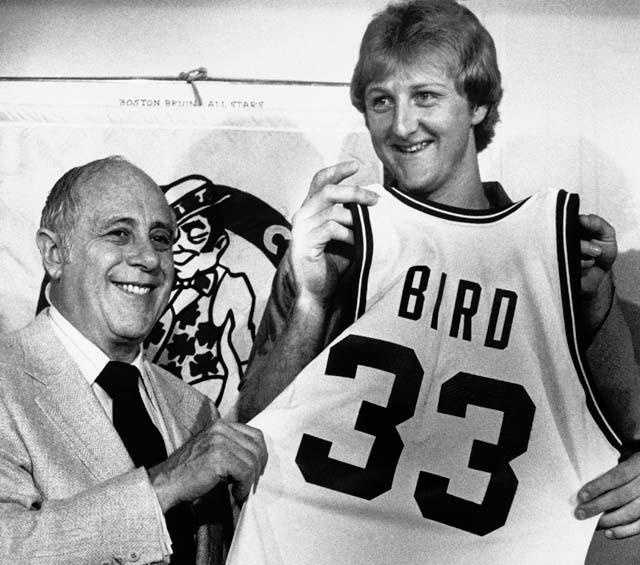 Larry Bird displays his new uniform with Celtics President Red Auerbach on June 8, 1979. Bird became the richest rookie in sports history when he signed a contact calling for $3.25 million over five years.