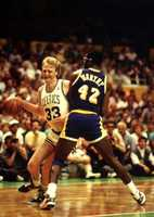 Larry Bird tries to drive around James Worthy of the Lakers in this 1987 NBA Finals game in Boston.