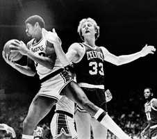 Los Angeles Lakers Magic Johnson rips a rebound from the hands of Larry Bird during a game on Dec. 28, 1979.