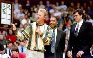 Larry Bird and Dennis Johnson present Kevin McHale a with a replica of the banner raised at Boston Garden during a ceremony retiring McHale's number on Jan. 30, 1994