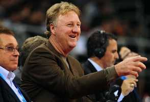 Larry Bird gestures from his seat during a game between the Denver Nuggets and the Indiana Pacers in Beijing on October 11, 2009.
