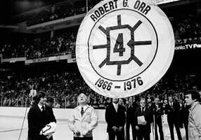 Bobby Orr watches as a pennant bearing his No. 4 is raised to the rafters of the Boston Garden at a ceremony retiring his number, Jan. 9, 1979.