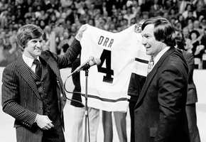 Bobby Orr and former captain John Bucyk hold up jersey No. 4 during ceremonies retiring Orr's jersey at the Boston Garden, Jan. 9, 1979