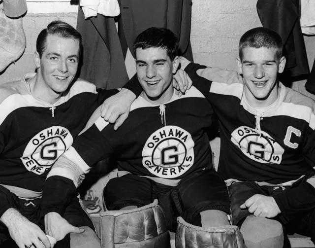Bobby Orr (R) poses with Oshawa Generals teammates Danny O'Shea and Ian Young in the locker room on Apr. 28, 1966.