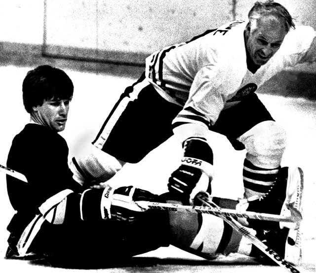 Bobby Orr trips up another hockey old timer, Gordie Howe, right, during Masters of Hockey game Feb.4,1983 in the Boston Garden.
