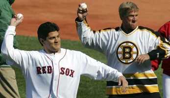 Patriots linebacker Tedy Bruschi and Bobby Orr throw out the ceremonial first pitch prior to the game against the New York Yankees April 11, 2005.