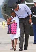 Barack Obama and his daughter Malia arrive to board Air Force One.