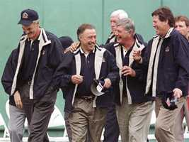 Carl Yastrzemski and Carlton Fisk share a laugh with Dwight Evans and Jerry Remy after ceremonies honoring 100 years of Boston Red Sox baseball in 2001.