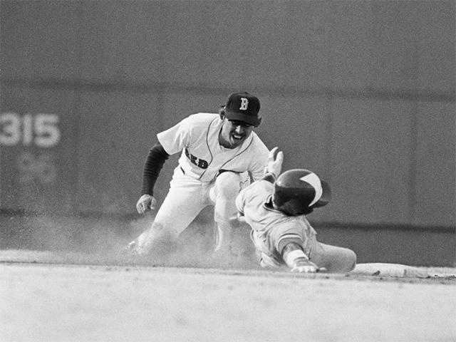 Remy closes his eyes and opens his mouth as Toronto Blue Jays first baseman Willie Upshaw slides into his tag, April 19, 1982.