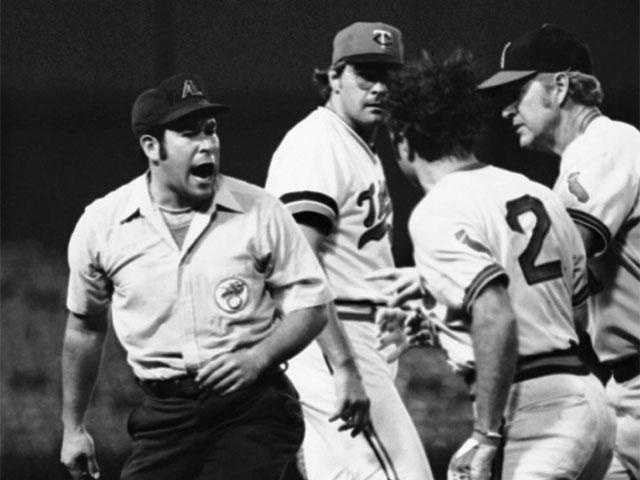 Then a member of the California Angeles in 1977, Remy and umpire Alan Clark argue after Remy was called out on a close play.