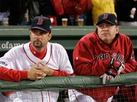 Tim Wakefield and Schilling look on from the bench during Game One of the 2007 World Series against the Colorado Rockies.