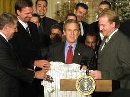 President George Bush gets a jersey from Schilling at the White House after the Diamondbacks World Series win.