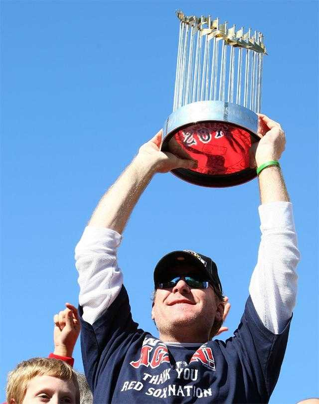 Schilling holds up the World Series Trophy during the Boston Red Sox World Series victory celebration on October 30, 2007 in Boston.