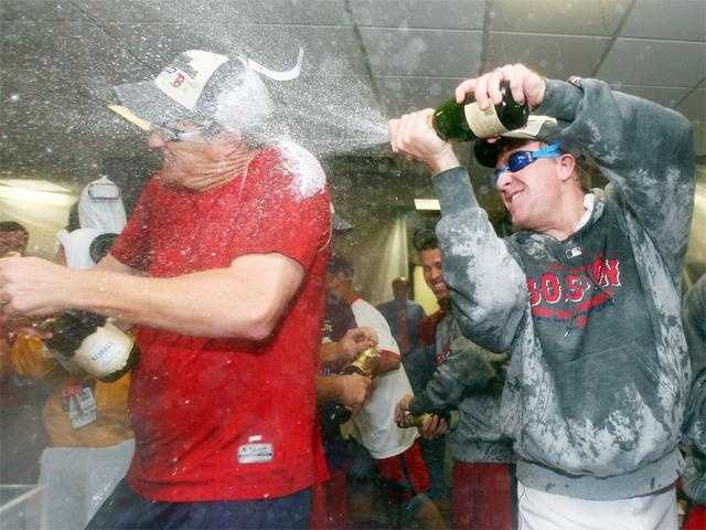 Mike Timlin and Schilling celebrate after clinching the American League East Division Championship on September 28, 2007